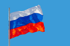Russia flag. Is waving in front of blue sky Royalty Free Stock Photo