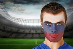 Russia football fan in face paint Royalty Free Stock Photos