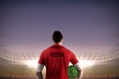 Russia football player holding ball Stock Images