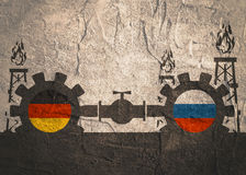 Russia and Germany flags on gears. Image relative to gas transit from Russia to Germany . Gears connected by gas pipe. National flags on cog wheels. Concrete Stock Photo