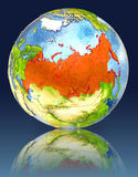 Russia on globe with reflection. Illustration with detailed planet surface. Elements of this image furnished by NASA Royalty Free Stock Photography