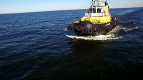 RUSSIA GULF OF FINLAND- 12 JUNE 2016: Aerial shot of a tugboat in sea stock video