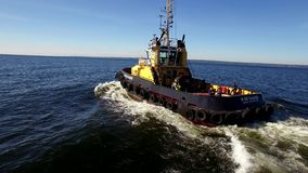 RUSSIA GULF OF FINLAND- 12 JUNE 2016: Aerial shot of a tugboat in sea stock video footage