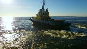 RUSSIA GULF OF FINLAND- 12 JUNE 2016: Aerial shot of a tugboat in sea stock footage