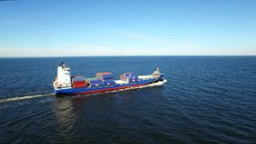 RUSSIA GULF OF FINLAND- 12 JUNE 2016: Aerial view over cargo transport ship sailing stock video