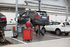 Russia, Izhevsk - April 21, 2018: Service center Toyota. Replacement and wheel alignment on a hydraulic lift. Modern service stock photo