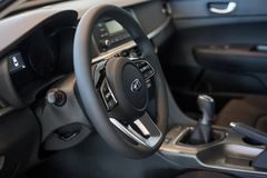 Russia, Izhevsk - July 4, 2019: Showroom KIA. Interior of new modern car business class Optima. With automatic transmission.Famous world brand stock photography