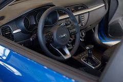 Russia, Izhevsk - July 4, 2019: Showroom KIA. Interior of new modern Rio X-Line with automatic transmission. Modern and prestigious vehicles royalty free stock photo