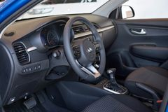 Russia, Izhevsk - July 4, 2019: Showroom KIA. Interior of new modern Rio X-Line with automatic transmission. Modern and prestigious vehicles stock image