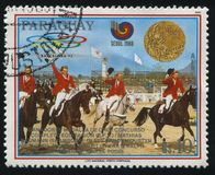 Summer Olympic Games in Seoul. RUSSIA KALININGRAD, 19 APRIL 2017: stamp printed by Paraguay, shows equestrian team at Summer Olympic Games in Seoul, circa 1989 Stock Images