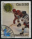 Hockey team from the USA at Winter Olympics at Lake Placid. RUSSIA KALININGRAD, 19 APRIL 2017: stamp printed by Paraguay, shows the hockey team from the USA at Royalty Free Stock Images