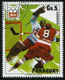 Hockey team at Winter Olympics at Innsbruck. RUSSIA KALININGRAD, 19 APRIL 2017: stamp printed by Paraguay, shows the hockey team at Winter Olympics at Innsbruck Stock Images