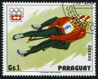 Luge athletes at Winter Olympics in Innsbruck. RUSSIA KALININGRAD, 19 APRIL 2017: stamp printed by Paraguay, shows Luge athletes at Winter Olympics in Innsbruck Stock Image