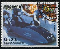 Winter Olympics in Calgary. RUSSIA KALININGRAD, 19 APRIL 2017: stamp printed by Paraguay, shows 4 man bobsled at Winter Olympics in Calgary, circa 1988 Stock Photos