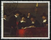 Sampling Officials of the Draper`s Guild by Rembrant. RUSSIA KALININGRAD, 19 APRIL 2017: stamp printed by Paraguay, shows Painting The Sampling Officials of the stock images