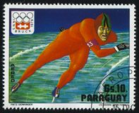 Winter Olympics in Innsbruck. RUSSIA KALININGRAD, 19 APRIL 2017: stamp printed by Paraguay, shows speed skater at Winter Olympics in Innsbruck, circa 1976 Royalty Free Stock Photo
