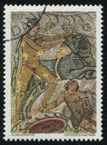 Punishment of Dirce. RUSSIA KALININGRAD, 12 NOVEMBER 2016: stamp printed by Yugoslavia, shows the mosaics, Punishment of Dirce, circa 1970 Stock Photos