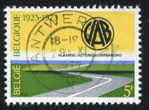 Highway Automobile Club Emblem. RUSSIA KALININGRAD, 19 OCTOBER 2015: stamp printed by Belgium, shows Highway, Automobile Club Emblem, circa 1973 stock photography