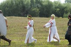 RUSSIA, KALUGA REGION, DZERZHINSKY DISTRICT, DVORTSY - JUL 14, 2018: Reconstruction of military operations in 1480. Mongol-Tatar s. Oldiers are Russian girls royalty free stock image