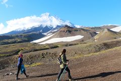 Hikers are on the route to volcano royalty free stock images