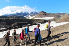Hikers are on the route to volcano royalty free stock photo
