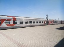 Russia, Kamenka - 11 August 2018 : the Train of the Russian Railways on the station platform Belinskaya stock image