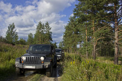 Russia, Karelia, July 16, 2015: photo jeep wrangler on a forest road in Karelia Royalty Free Stock Images