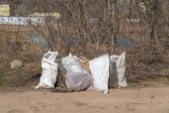Russia, Kazan - April 20, 2019: Garbage bags on the river bank. royalty free stock image