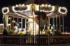 Russia, Kazan, may 2, 2018, children`s carousel in the Park in the evening, editorial royalty free stock image