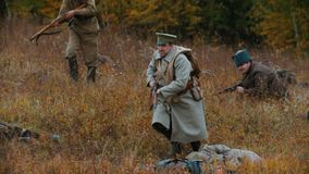 Russia, Kazan 30-09-2019: A reconstruction of military operations in Russia in 1917 - Performing hostilities - Soldiers. In the midst of battle. Mid shot stock video