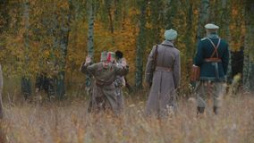 RUSSIA, KAZAN 30-09-2019: A reconstruction of military operations in Russia in 1917 - Performing hostilities - Soldiers. Walking on the field - One of them stock video