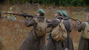 Russia, Kazan 30-09-2019: A reconstruction of military operations in Russia in 1917 - Performing hostilities - Soldiers. Standing in the row holding guns and stock video footage