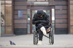 Russia, Kazan 14 september 2016, dowmtown - Disabled homeless man on a wheelchair begging for money - drunk beggar Stock Photos