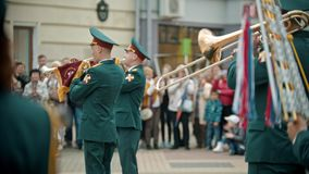 Russia, Kazan 09-08-2019: A wind instrument parade - military men on the street playing trumpets stock video