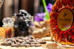 Russia Kemerovo 16-11-2018 buffet degustation with nuts, snacks, closeup luxury cognac in crystal bottle Remy Martin XO and glass stock images
