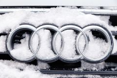 Russia Kemerovo 2018-12-23 closeup metal emblem brand icon Audi A6 with four rings, covered with fluffy snow. Concept German stock photos