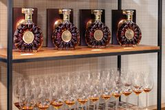 Russia Kemerovo 16-11-2018 degustation premium vip cognac Remy Martin XO at opening men's clothes store, crystal bottles with. Golden cork, wine glasses with royalty free stock image