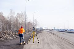 Russia Kemerovo 2019-03-15. Land and construction surveyor equipment. Geodesist controls robotic total station theodolite. royalty free stock photos