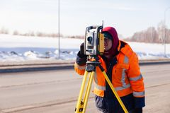 Russia Kemerovo 2019-03-15. Land and construction surveyor equipment. Geodesist controls robotic total station theodolite. Equipment mapping construction royalty free stock image