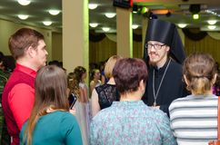 Orthodox priest talking to people at the feast royalty free stock image