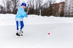 RUSSIA, KOROLEV- FEBRUARY 18, 2017: Young hockey player have a warm up training before the match on bandy tournament in royalty free stock photo