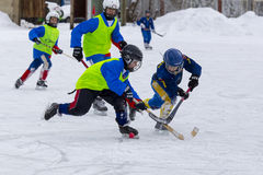 RUSSIA, KOROLEV - JANUARY 15, 2015: 3-d stage children's hockey League bandy, Russia. Stock Photography