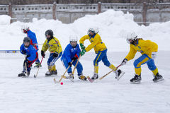 RUSSIA, KOROLEV - JANUARY 15, 2015: 3-d stage children's hockey League bandy, Russia. Royalty Free Stock Image