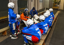 RUSSIA, KOROLEV - JANUARY 15, 2015: 3-d stage children's hockey League bandy, Russia. Team listening to the coach before going on royalty free stock image