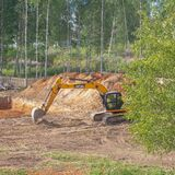 Russia Kostroma 07 23 2021 Excavator digs a pit for the construction of a house, digging sand for the construction of