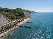 Bird`s eye view of the city beach, railway station of the village of Gizel-Dere on a hot sunny summer day stock photos