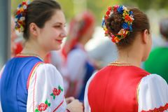 Procession of students of the Institute of culture, the faculty of folk culture of Kuban Cossack in national attire with a loaf a. Russia, Krasnodar 09.09.16 royalty free stock images