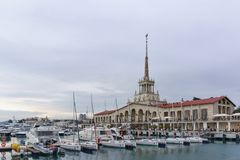 White yachts and boats standing at the pier in the waters of the seaport of Sochi on a cloudy spring evening Royalty Free Stock Photos