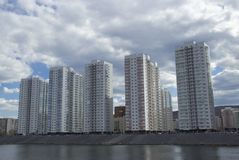 High multi-storey residential buildings on the river Bank royalty free stock photography