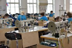 Women work in a felt boots factory Royalty Free Stock Photo